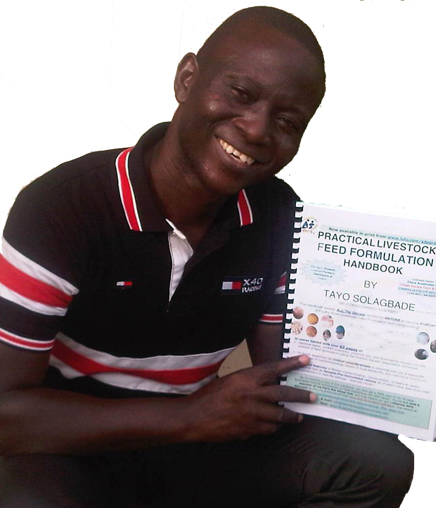 Holding a Ready-to-Dispatch Print Copy of My Popular Practical Feed Formulation Handbook