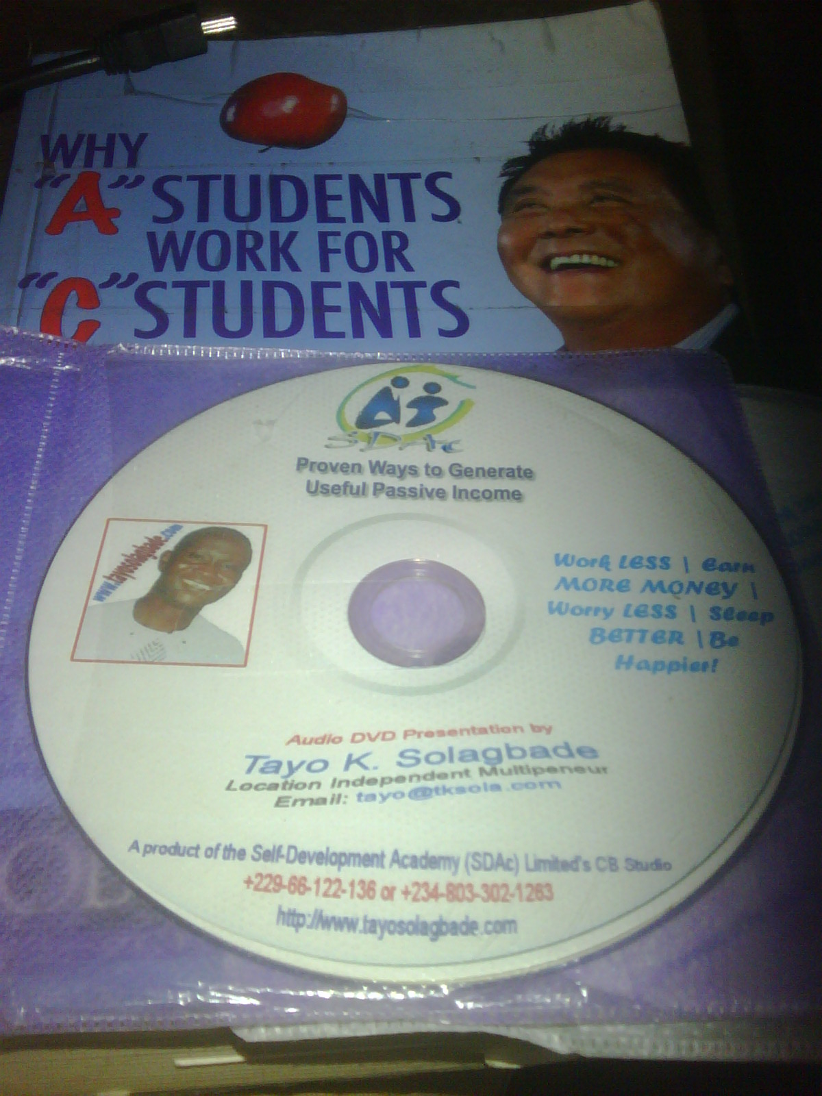 Photograph of my latest Audio DVD Information Product titled Proven Ways to Generate Useful Passive Income (sitting on my copy of Robert Kiyosaki's Why 'A' Students Work for 'C' Students, and 'B' Students Work for the Government)